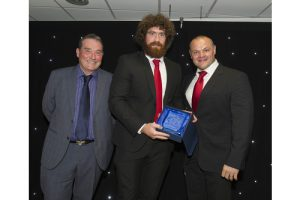 Rugby Star With Award