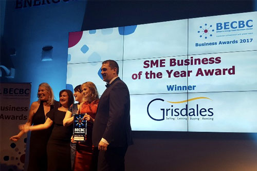 Grisdales collecting their award